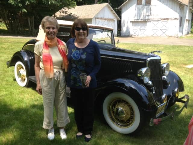 Volunteer, Sheila Granowitz, with John Fell House Board member Pat Finn outside the John Fell House barn.