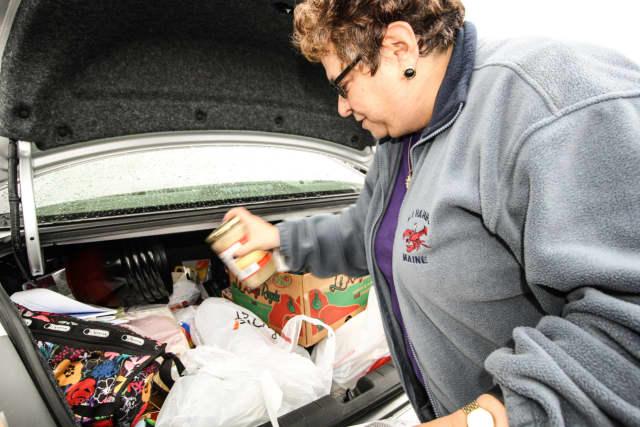 Helene Kornstein fills her car with Pathmark items.