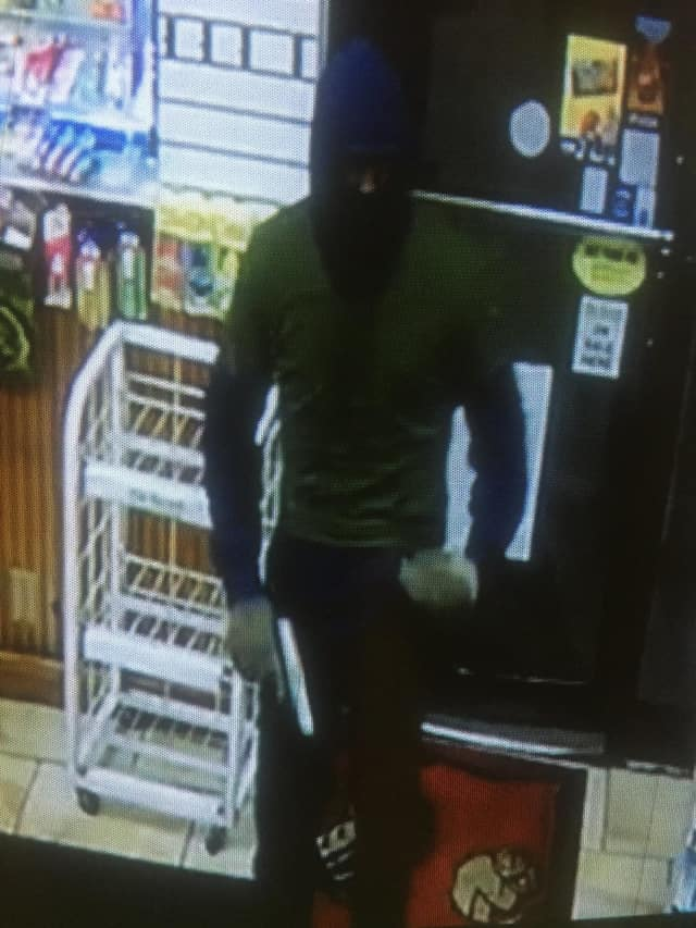 The robber wore a ski mask and gloves and carried a silver handgun.