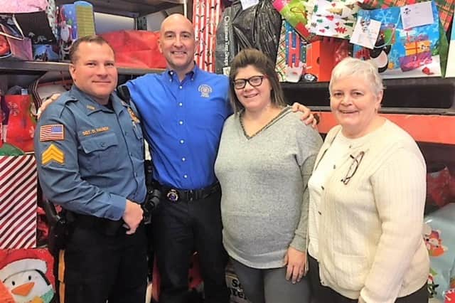 FROM LEFT: PBA Local #218 Member Sgt. Don Hausch, PBA Member Lt. Ed Kane, CUMAC employee Jennifer Miller, long time CUMAC volunteer Kathleen Altobello