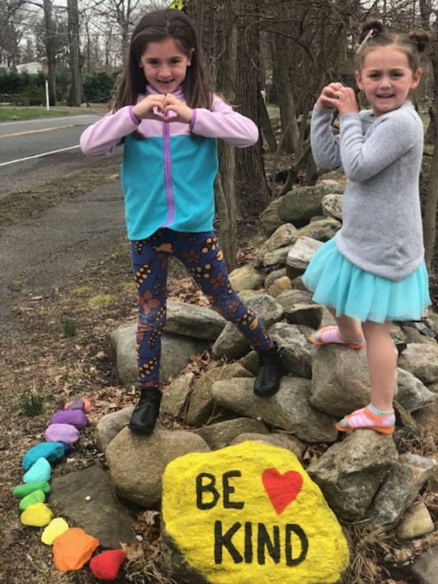 Gianna (left) and Chelsea (right) Andriopoulus worked with their mother to create an art project that has turned into a warm-hearted message.