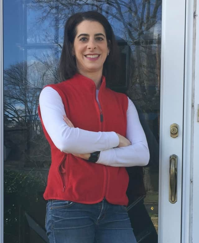 Glen Rock's Jessie Schwartzfarb-Lipson wears red to spread awareness on Day Without Women. She stayed home from work on Wednesday. Her bosses are fully supportive.