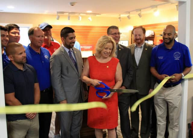 Passaic County Freeholder Director Cassandra Lazzara cuts the ribbon on the new golf shop at Preakness Valley Golf Course in Wayne.