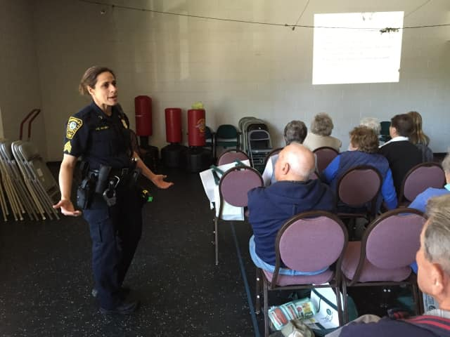Sgt. Sofia Gulino of the Norwalk Police Department talks to seniors on Wednesday.