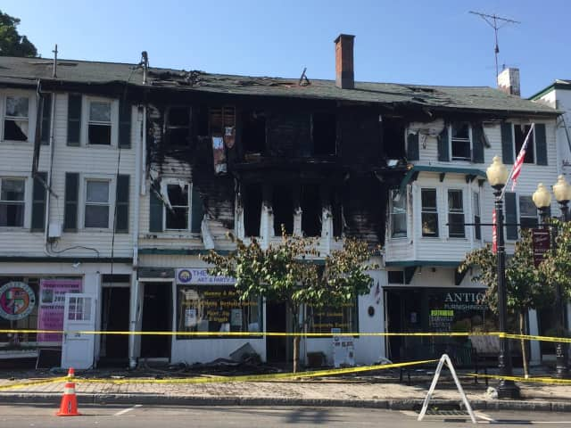 Eight families are homeless after a fire ripped through the landmark building on Greenwood Avenue in Bethel early Thursday.