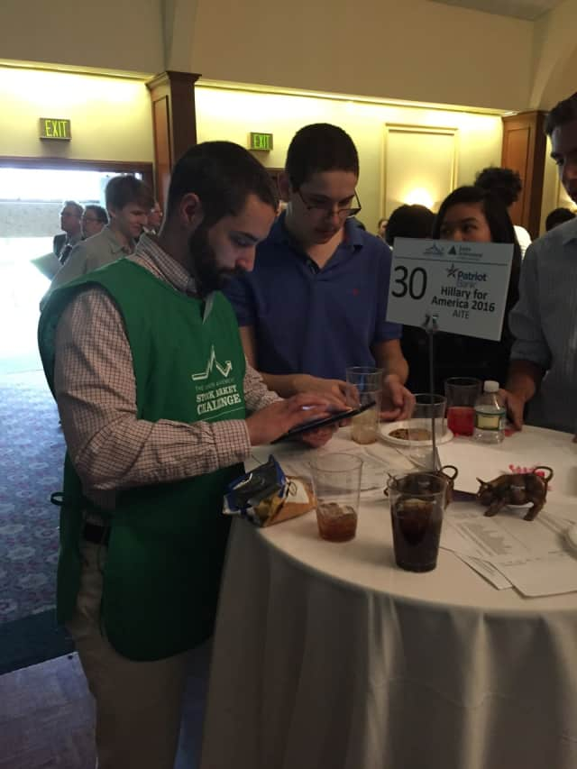 AITE Senior Daniel Ruskin works with a trader during a trading simulation in Stamford on Thursday.