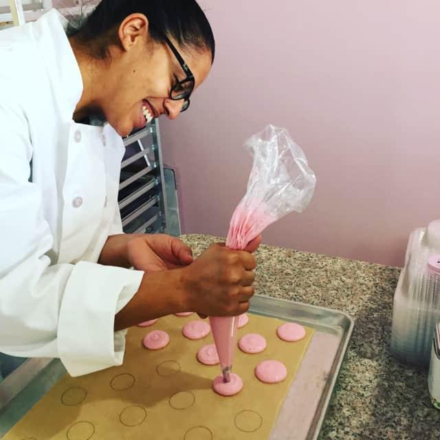 Yanneris Gennao of Yani's Bakehouse in Fair Lawn prepares guava macarons.