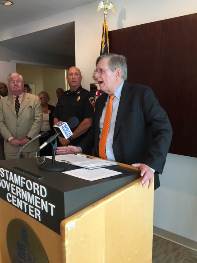 Here, Stamford Mayor David Martin called for an end to violence and for universal background checks during a June event.