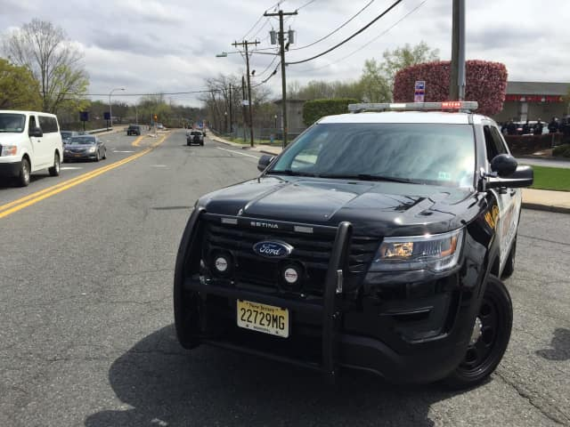Police close off traffic on the Anderson Street Bridge in Hackensack leading into Teaneck.