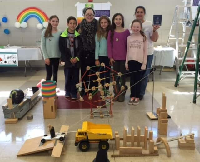 """The Briarcliff Middle School """"Toy Squad"""" stands behind their award winning Rube Goldberg machine."""