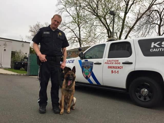 Little Ferry Police Detective Ron Callahan and Quentin, the department's newest canine officer.
