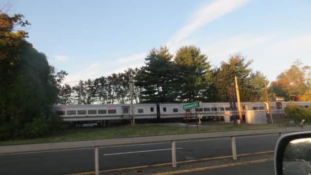 A northbound commuter train passes through the Commerce Street railroad crossing in Mount Pleasant. The Valhalla crossing was the site of the deadliest crash in Metro-North history in February 2015.