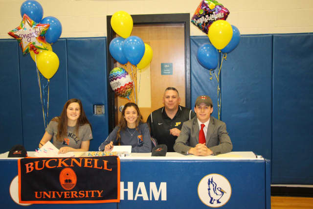 L to R: Madison Hartigan, Claire Gilman, Athletic Director Stephen Luciana and Ben Girolamo.
