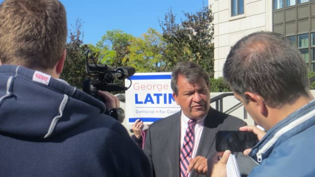 Former state Sen. George Latimer, a Democrat from Rye, answered reporters' questions outside the U.S. Federal Court about a corruption investigation that involved alleged gifts by a chaplain to then-County Executive Rob Astorino.