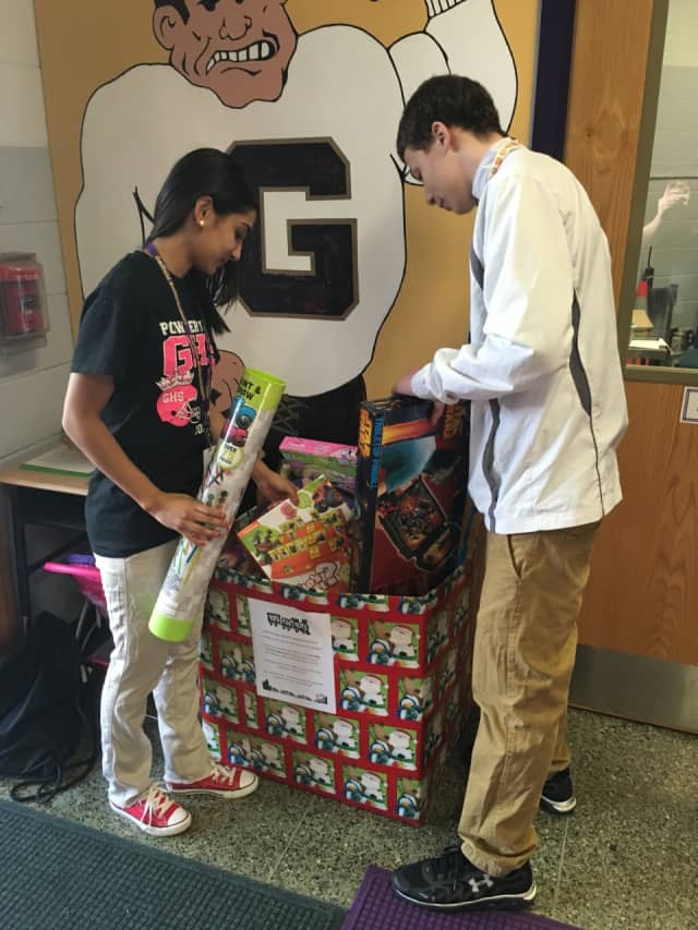 Garfield High School students Destiny Rivera and Omar Ayoub help out at a recent Toys for Tots drive.