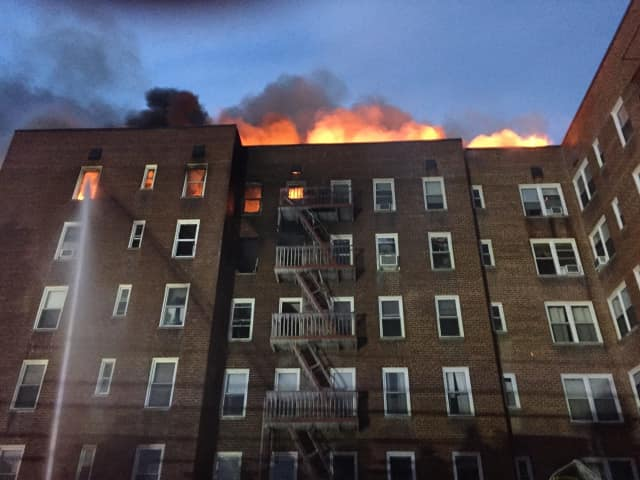 The fire broke out in the upper floors of the apartment complex at 1 Hawley Terrace, off Warburton Avenue, and spread through the roof.