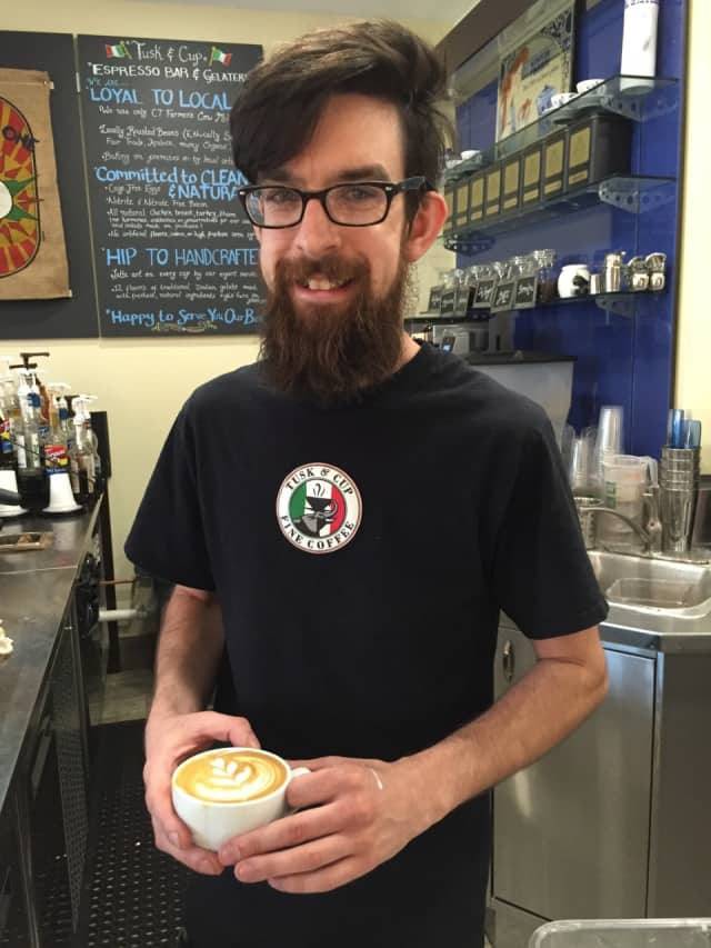 Jason Varga of Tusk & Cup in Wilton and Ridgefield shows a cup of a perfectly formed beverage.