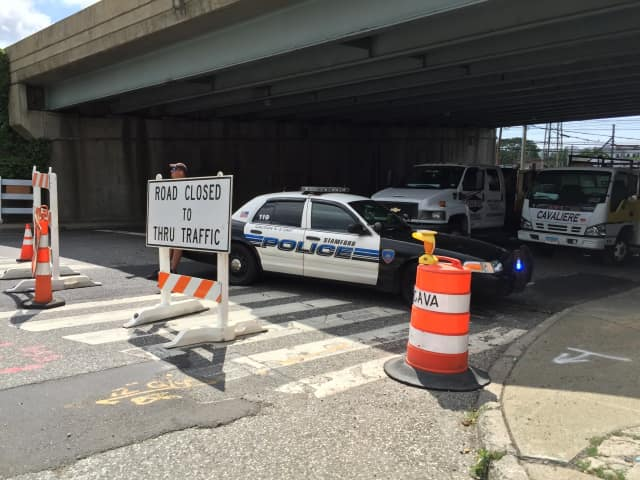 A Stamford police cruiser blocks off the southbound side of Atlantic Street Wednesday due to construction.