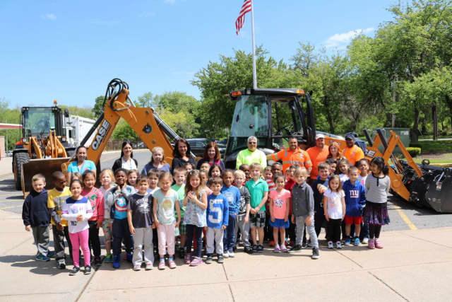 Ward Elementary School students visit the Department of Public Works' big trucks.