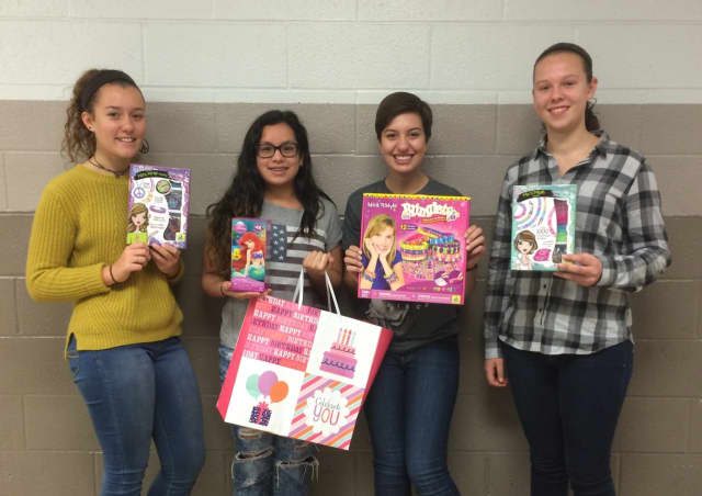 Glen Rock resident Jocelyn Greer, at right, and her classmates collect birthday gifts for children in need. Her group includes Caroline Virone, Betsally Falcones and Olivia Vladyka.
