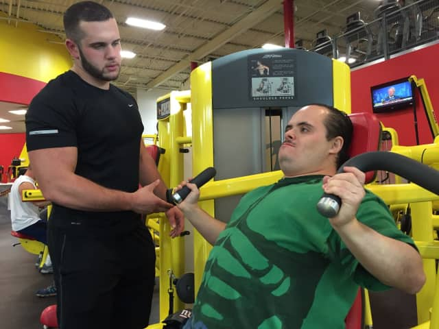 Enrico Addeo trains Alex Rivera of Englewood at Retro Fitness Hackensack.