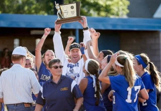 Keith Johnson celebrates a 2016 state title with the Northern Valley Demarest softball team.