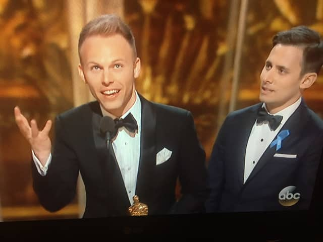 "Justin Paul, left, with Benji Pasek, at their Oscar win for ""La La Land."""