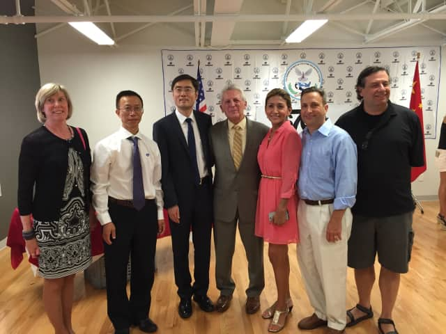 Norwalk Mayor Harry Rilling, state Sens. Bob Duff and William Tong along with local officials welcome the Chinese Olympic Swim Team to Norwalk on Friday.