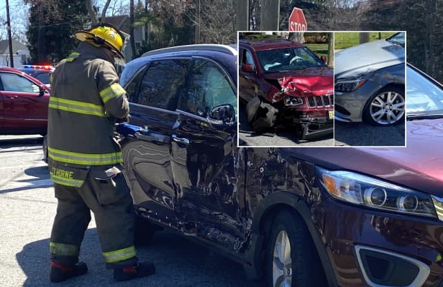 Hawthorne firefighters at work following crash at Utter and Lincoln avenues.