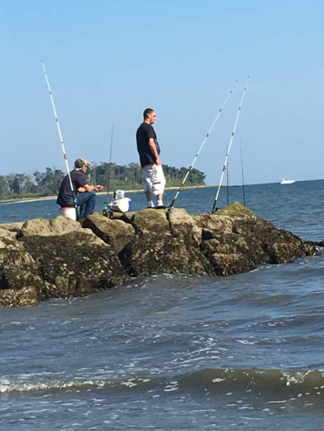It's still warm enough to enjoy fishing along Long Island Sound. These fishermen are at Silver Sands State Park in Milford.