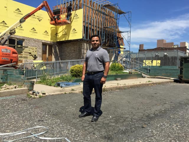 Kal Patel outside of the soon-to-be Lightbridge Academy in Bergenfield.