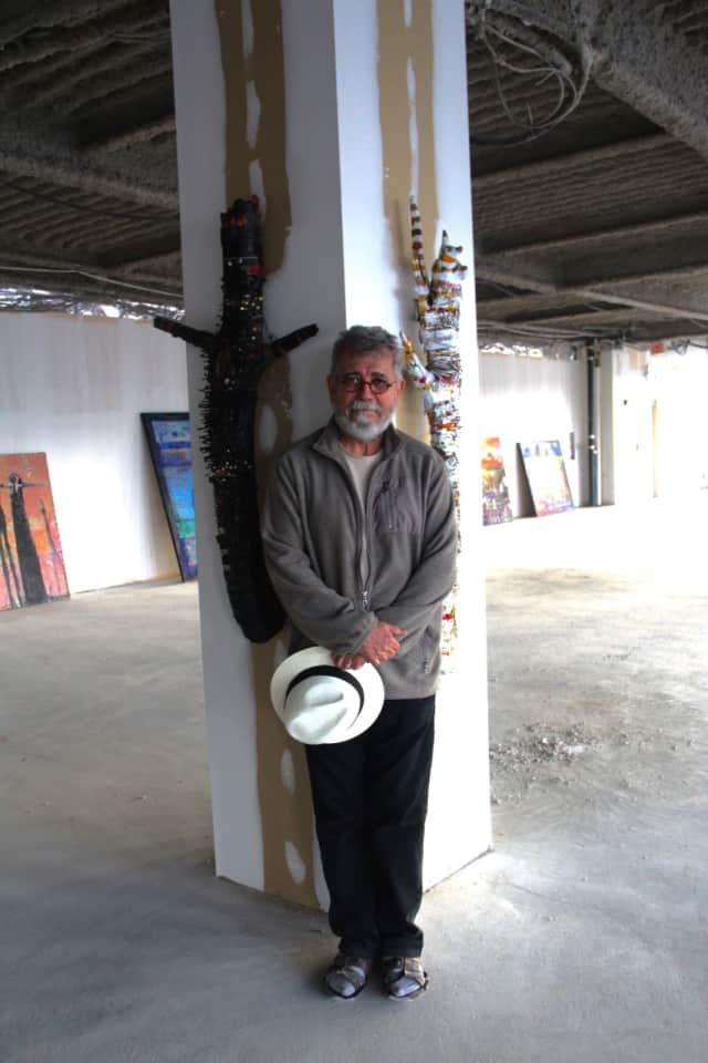 Lee Romero, a retired New York Times photographer, Pulitzer Prize winner and now a full time artist with a studio in the new Carpet Mills Arts District.
