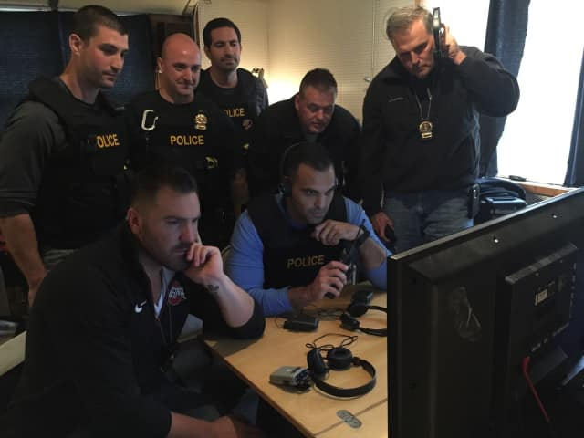 Fairfield Police observe suspects on television monitors last week.