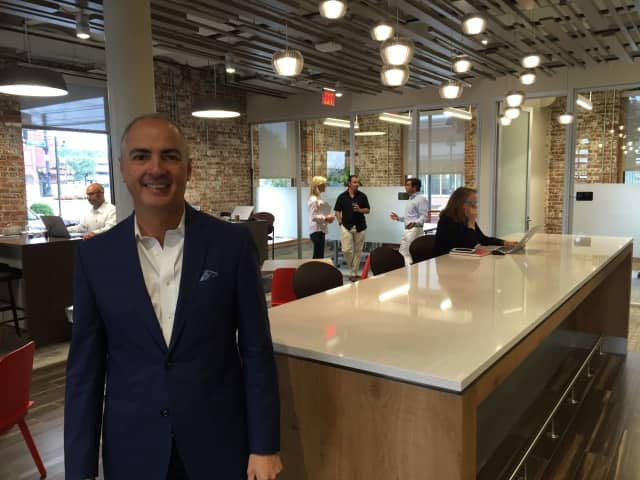 John Arenas, CEO and founder of Serendipity Labs, which has more than 100 co-working locations, stands in the company's new Stamford location.
