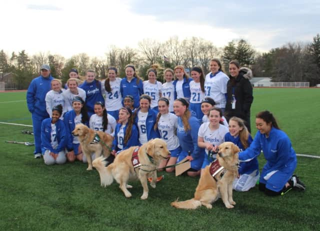 Holy Angels Lacrosse and service dogs from Mickey's Kids.