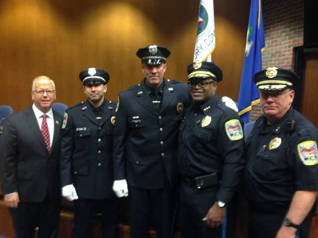 From left: Mayor Mark D. Boughton, Detective John Rudisill, Detective Robert Perun, Chief Patrick A. Ridenhour and Deputy Chief Shaun J. McColgan at Tuesday's swearing-in ceremony.