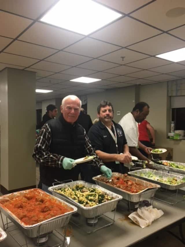 Elks Ed Flynn and Mike Picarello serve dinner for veterans at the Montrose VA.