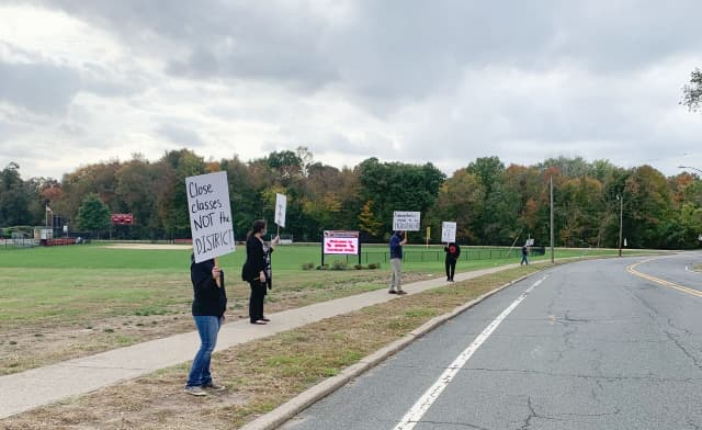 Parents protest the sudden closure of the Westwood Regional School District Oct. 19.