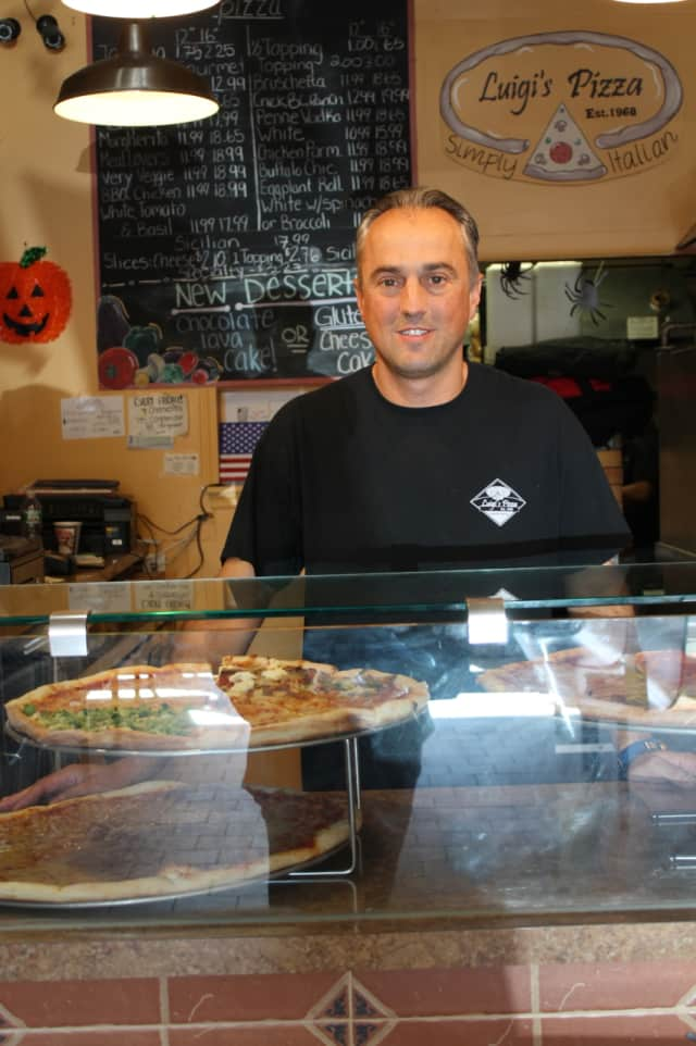 Anthony Martinelli, owner of Luigi's Pizzeria, stands behind the counter of his Ringwood establishment.