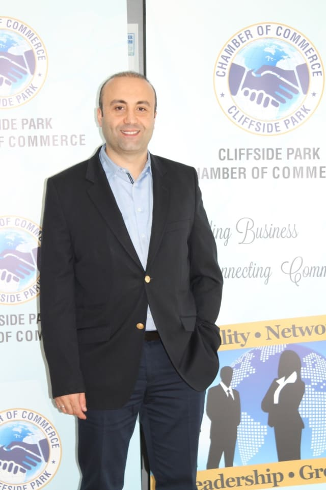 Cliffside Park Chamber of Commerce President Vedat Alp at his commercial insurance business on Anderson Avenue.