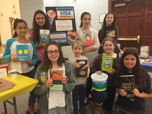 Youngsters at the Ridgewood Library kick off the reading marathon.