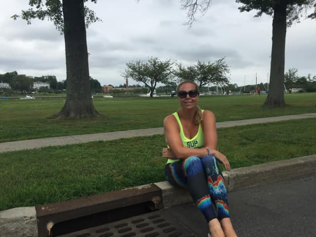 Nancy Vincent poses by a Mamaroneck drain.