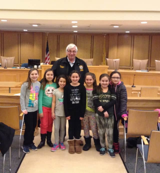 Girl Scouts visit Mahwah town hall with Mayor Bill Laforet.
