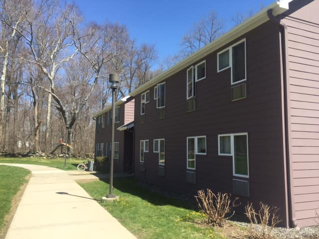The SUNY Purchase College dormitory where an argument began during a barbecue party on Sunday. A suspect displayed a gun before running off into the woods, pursued by campus and Harrison police. A 24-year-old suspect was arrested on Monday night.