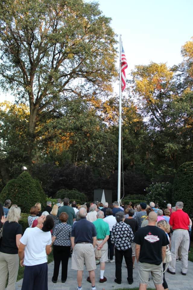 A crowd listens as 9/11 survivor Dan Fontana plays music at the 9/11 memorial ceremony in Glen Rock.