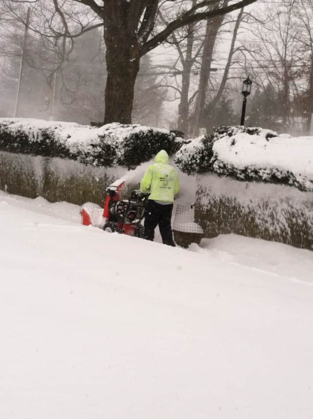 A man pushes a snowblower at a Ridgefield apartment complex on Prospect Street Thursday afternoon. The hard work could be dangerous for anyone who is not fit or has a history of heart disease.