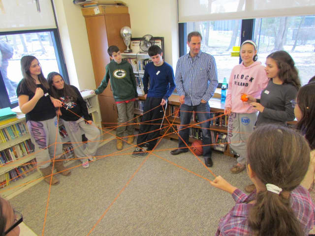 Irvington Middle School staff members and students participated in small group activities designed to promote the yearlong theme of building connections.