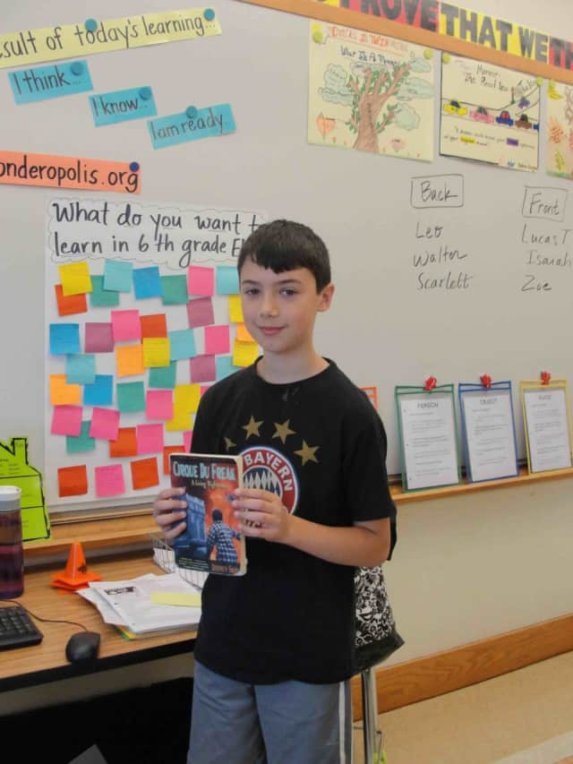 Irvington Middle School sixth-graders give short presentations for their classmates and discuss a book they've read.
