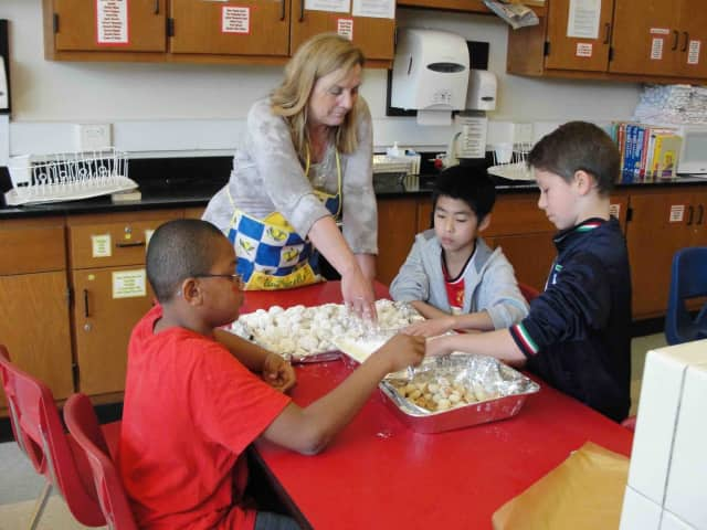 Irvington Middle School sixth-graders baked authentic Greek cookies during a PTSA-funded celebration of ancient Greece on March 18.