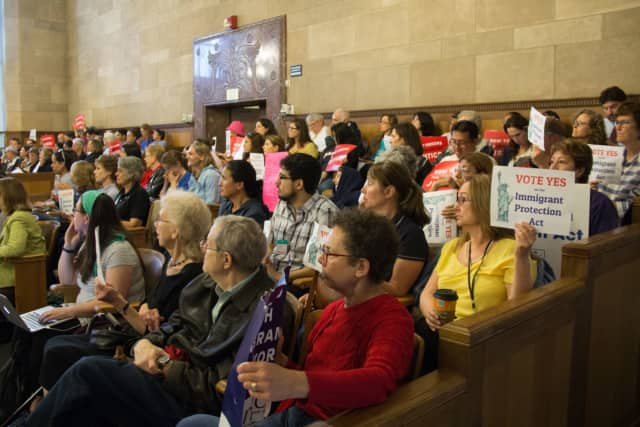 The scene at the Board of Legislators as the Immigrant Protection Act passed.